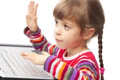 Little girl with a laptop Stock Photography
