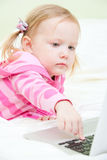 Little girl with laptop Royalty Free Stock Photography
