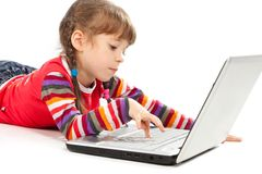 Little girl with a laptop Royalty Free Stock Photo