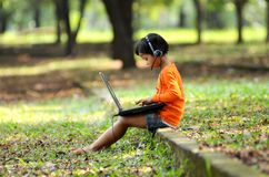 Little Girl with a laptop Royalty Free Stock Image
