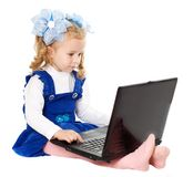 Little girl with laptop Royalty Free Stock Photo