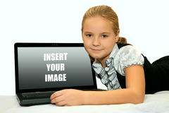 Little girl with laptop Stock Photo