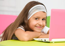 Little girl with laptop Stock Photography