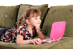 Little girl with laptop Stock Images