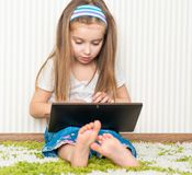 Little girl with a laptop Royalty Free Stock Photography