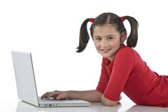 Little girl with laptop Stock Image