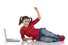 Little girl with laptop Stock Photos