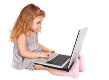 Little girl with laptop. On white background Stock Photo