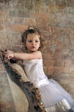Little girl  in a large antique chair Stock Photography