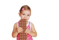 Little girl with large chocolate Stock Photo