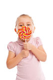Little girl with a large lollipop. Royalty Free Stock Photos