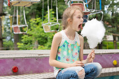 Little girl with a large stick of candy floss Royalty Free Stock Image