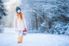 Little girl with latern in frozen forest on Christmas eve Royalty Free Stock Images