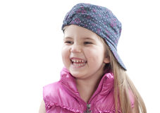 Little girl laughing. Little girl wearing baseball cap and hlaughing on white Royalty Free Stock Photography