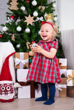 Little girl laughing and Christmas tree in decorated living room Royalty Free Stock Photos