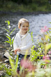 Little girl laughing in the park at river Stock Photos