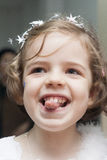 Little girl laughing and showing her tongue Stock Photography