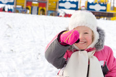 Little girl laughing in a snowy playground Stock Photography