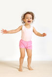 A little girl laughs. A little girl expresses the gladness Royalty Free Stock Photo