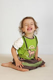 A little girl laughs. A little girl expresses the gladness Royalty Free Stock Photography