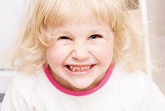 Little girl laughs and pleases Stock Image