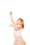 Little girl launching up paper plane Stock Photo