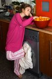 Little girl in laundry at home Stock Images