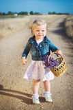 Little girl with lavender flower bouquet Royalty Free Stock Images