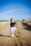 Little girl with lavender flower bouquet Stock Photography