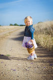 Little girl with lavender flower bouquet Stock Images