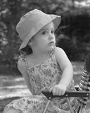 Little girl in lawnchair. Black and white portrait of a little girl in a hat Stock Photos