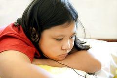 Little girl lay on floor listen music Royalty Free Stock Images