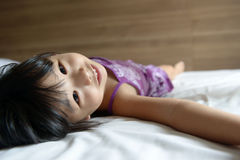 Little girl laying on bed Royalty Free Stock Images