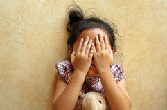 Little girl laying on floor, close her face Stock Photos