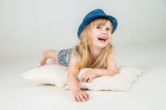 Little girl laying on the floor and looking right Stock Photos