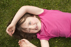 Little girl laying in grass Stock Photography