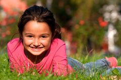 Little girl laying on grass Royalty Free Stock Images