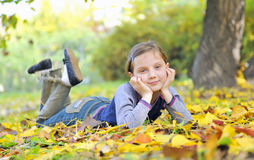 Little girl  laying on the grass Royalty Free Stock Images