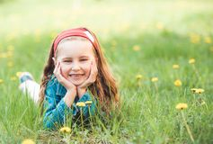 Little Girl Laying On Grass Royalty Free Stock Photography