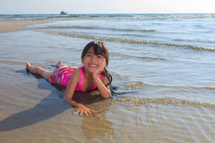 Little girl laying in water Royalty Free Stock Image