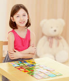 Little girl lays cards on the table Royalty Free Stock Photo