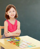 Little girl lays cards on the table Royalty Free Stock Image