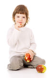 The little girl leads a healthy way of life, and eat apples Royalty Free Stock Photography