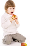The little girl leads a healthy way of life, and eat apples Royalty Free Stock Image