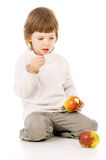 The little girl leads a healthy way of life, and eat apples Royalty Free Stock Photos