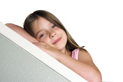 Little Girl Leaning. A little girl leaning on a bannister - Room for Text Royalty Free Stock Photography