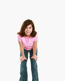 Little girl leaning on knees Royalty Free Stock Image