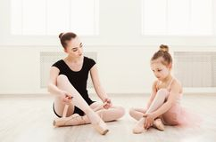 Little girl learn ballet with teacher copy space stock image