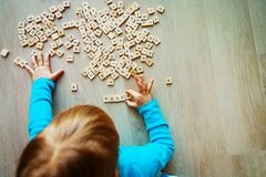 Little girl play with letter puzzle in school or daycare Stock Images