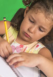 Little girl learn. On removable background Stock Image
